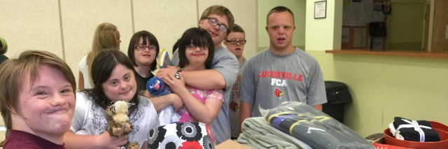 Students with Down syndrome packing refugee welcome boxes.