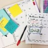 organized calendar, post it notes and wellness goals chart
