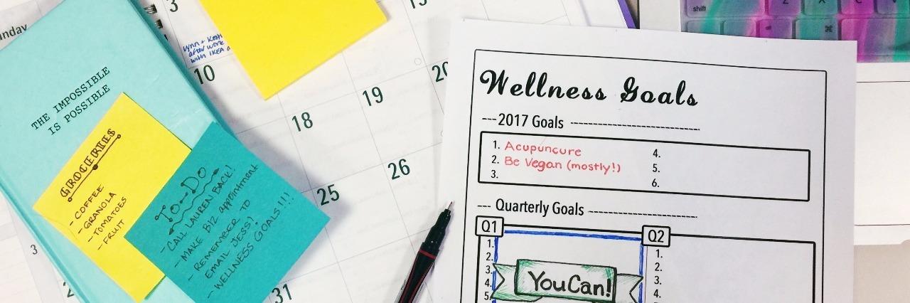 organized calendar, post it notes and wellness goals chart