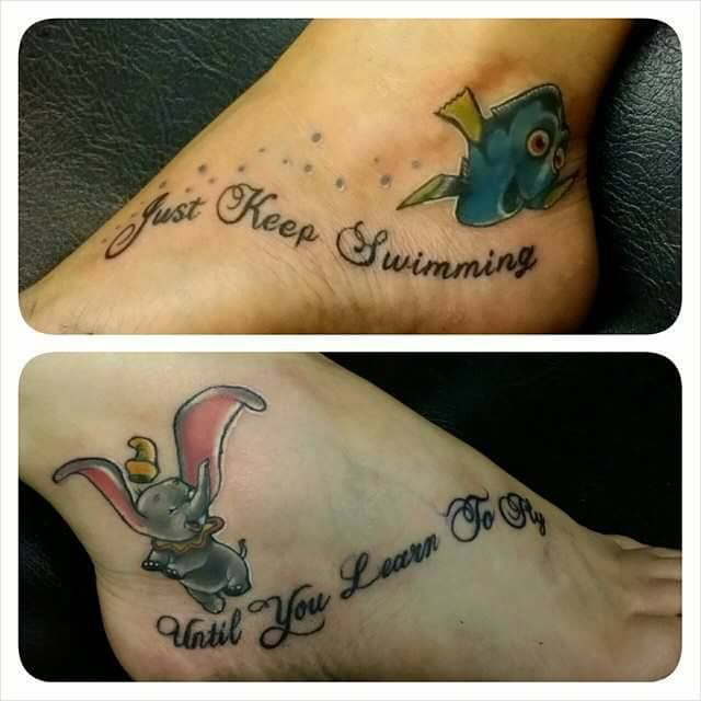 tattoos on foot of dory and words just keep swimming and dumbo and words until you learn to fly