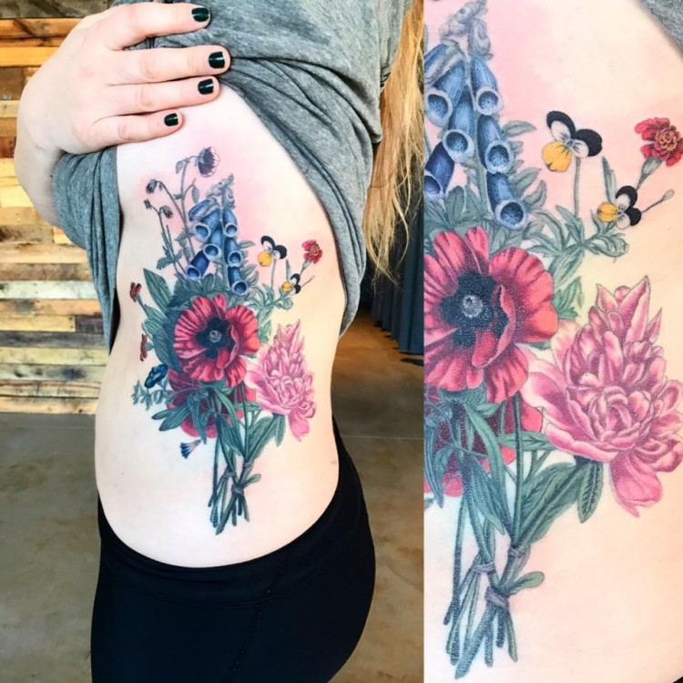 colorful tattoo of flowers on side of woman's body