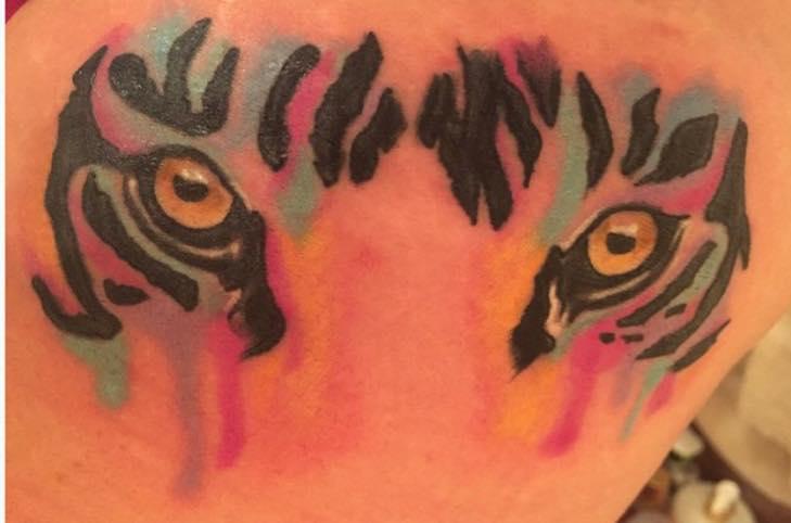 tattoo of tiger eyes