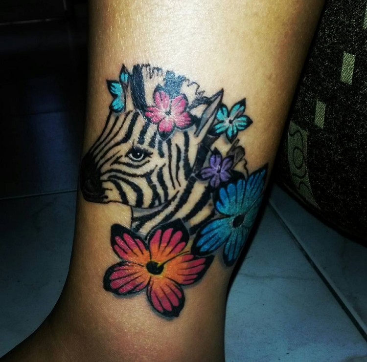 tattoo on leg of zebra and flowers