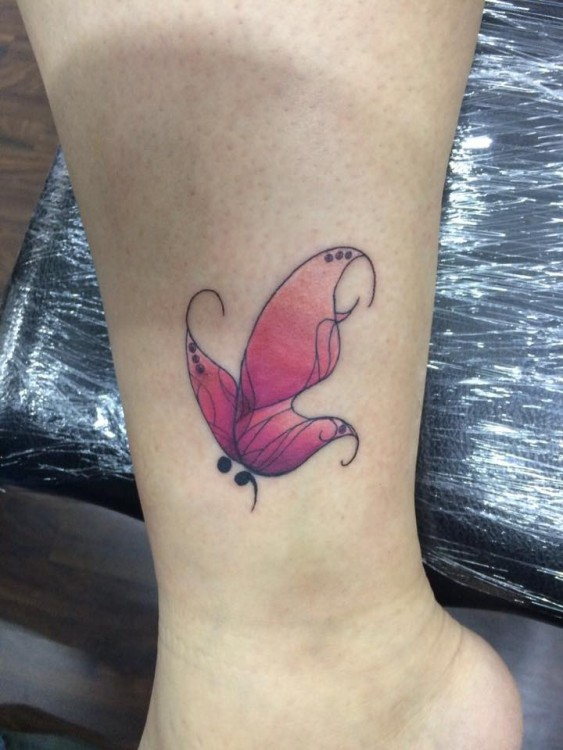 tattoo on ankle of butterfly and semicolon