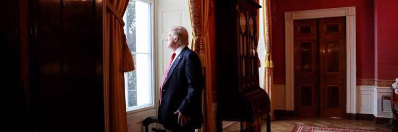 Donald Trump, looking out a window