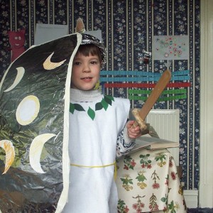 young boy dressed for medieval banquet