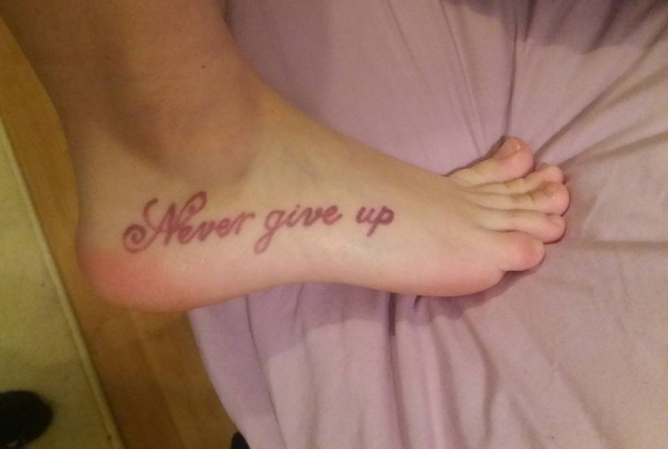 "A tattoo that says, ""Never give up."""