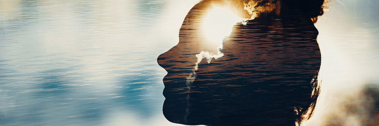 A double exposure of a woman and the sun in her head