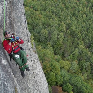 Enock climbing Cathedral Ledge.