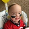 baby with down syndrome in football jersey