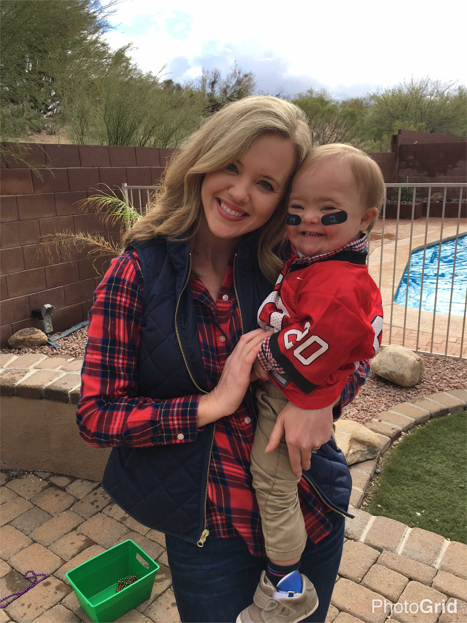 mom holding son with down syndrome on birthday