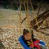 little girl with cantu syndrome in a swing