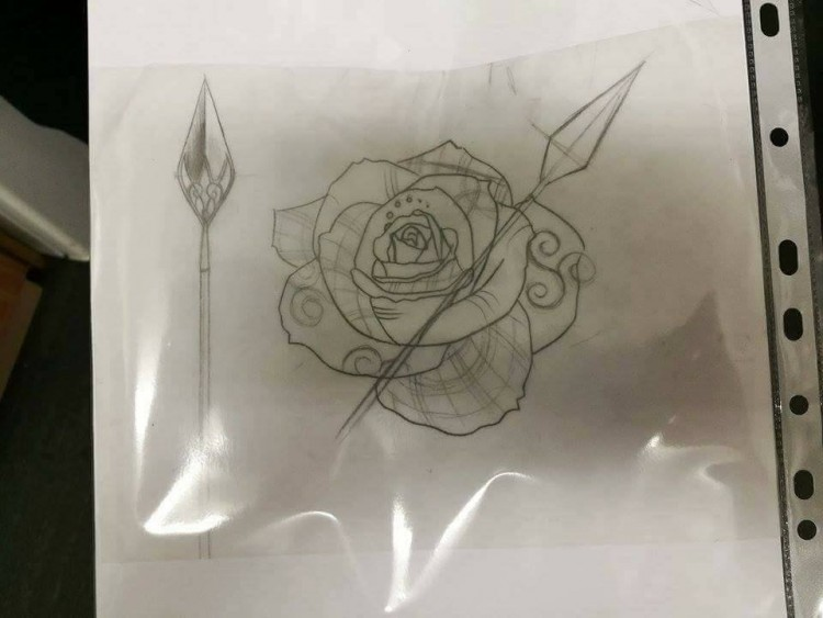 A sketch of a tattoo design with a flower