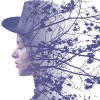Double exposure of girl wearing hat and autumn tree branches