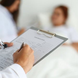 physician ready to examine patient