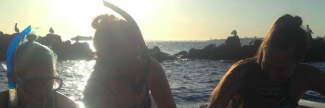 three women on a snorkeling trip