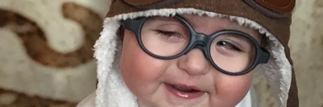 little boy wearing a brown hat