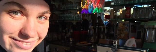 young woman sitting at the bar at a restaurant