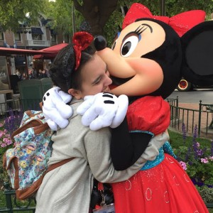 The author hugging Minnie Mouse at Disneyland