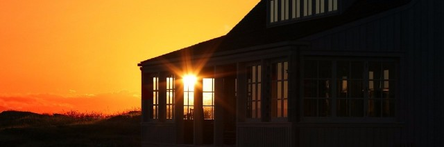 view of a home during sunset