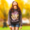 """A photo from the movie """"The Edge of Seventeen,"""" with actress Hailee Steinfield looking up toward the sky as she walks down the sidewalk"""