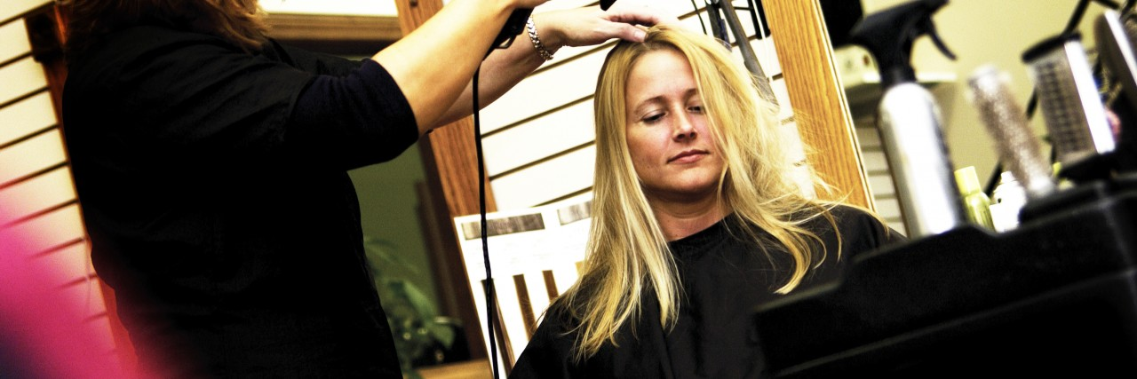 Woman at salon getting her hair done