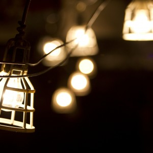 Glowing lamps hanging outdoors.