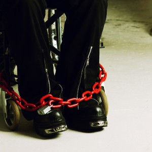 Person chained to wheelchair.