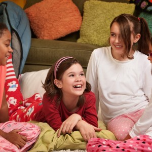 Girls laughing and talking at a slumber party