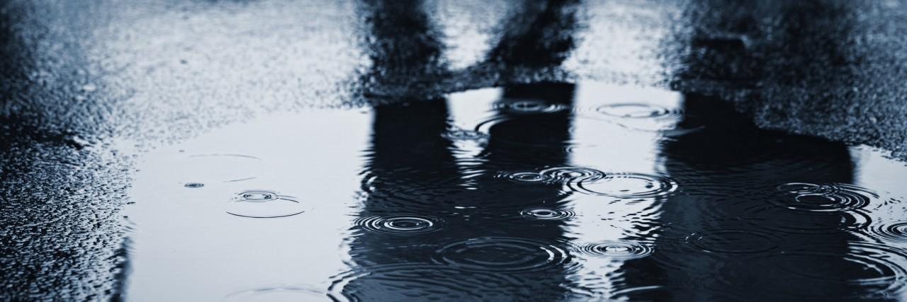 People standing in rain