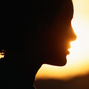 Silhouette of woman, close-up.