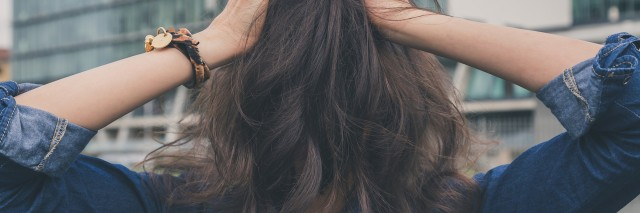 girl covering her face with her hair