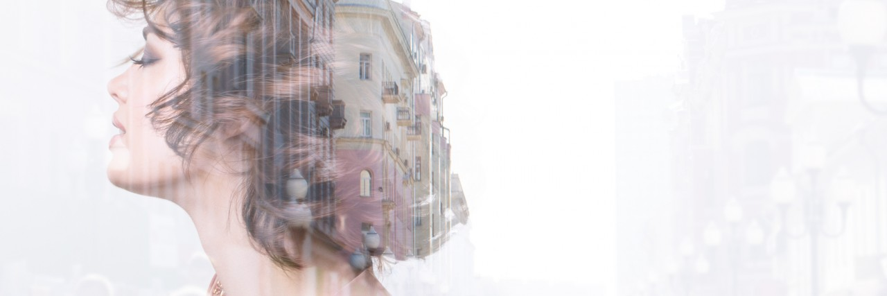 Double exposure woman and city.