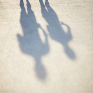 shadows of two people running outdoors