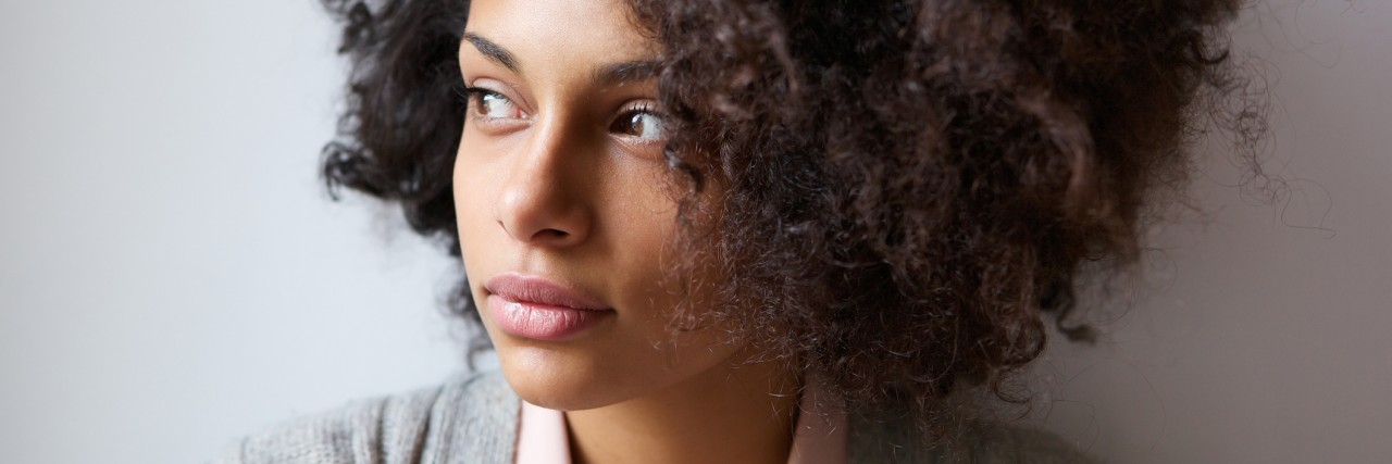 Close up portrait of a beautiful black woman looking away