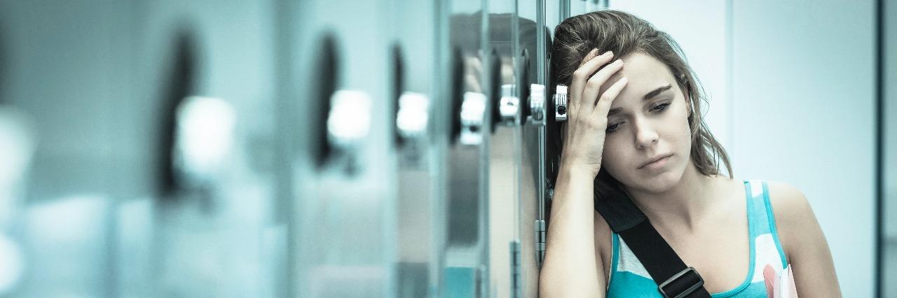 Wincing student having a headache
