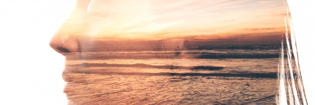 double exposure of a woman smiling and a photograph of a sunset on a beach