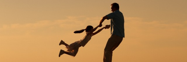 Father and daughter spending time together outdoors.