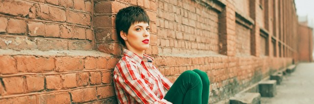 Outdoor portrait of young woman with short Hair