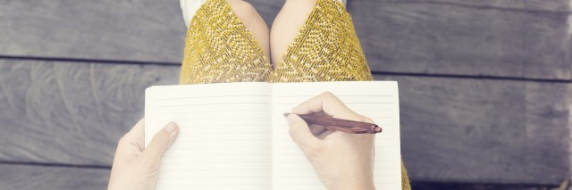 A woman writing in her notebook