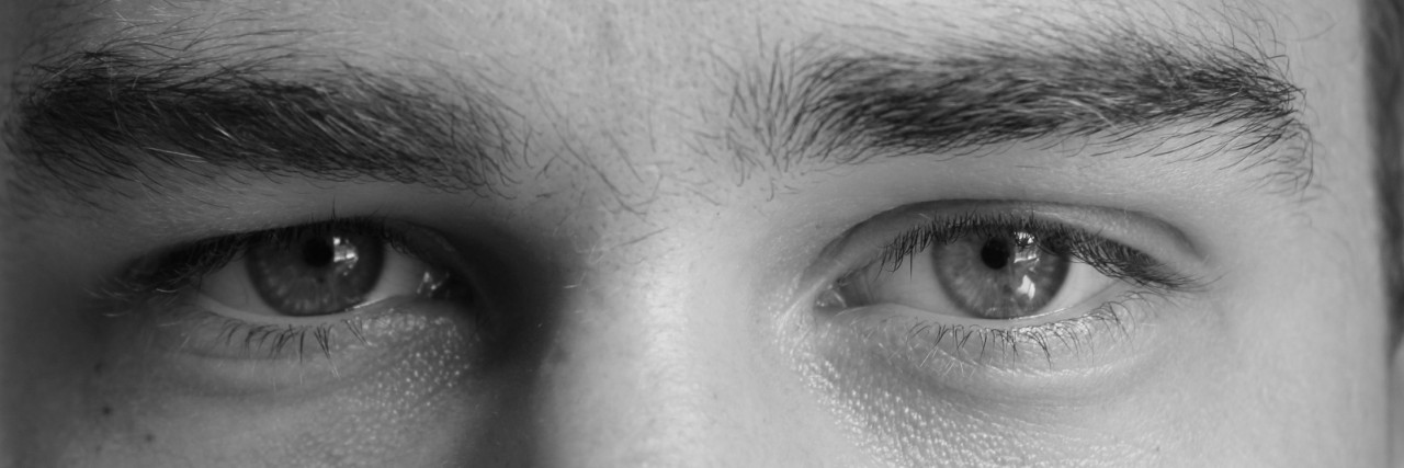 eyes of a man black and white