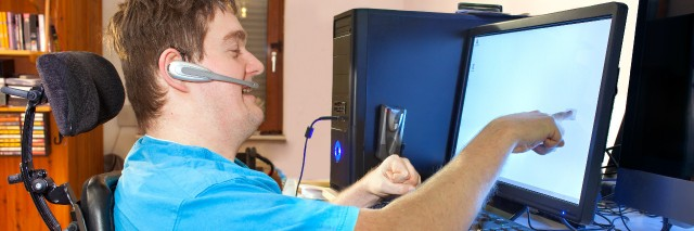 Man with cerebral palsy using a computer.
