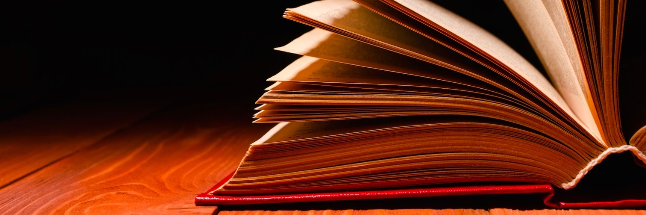 Book opened on wood table