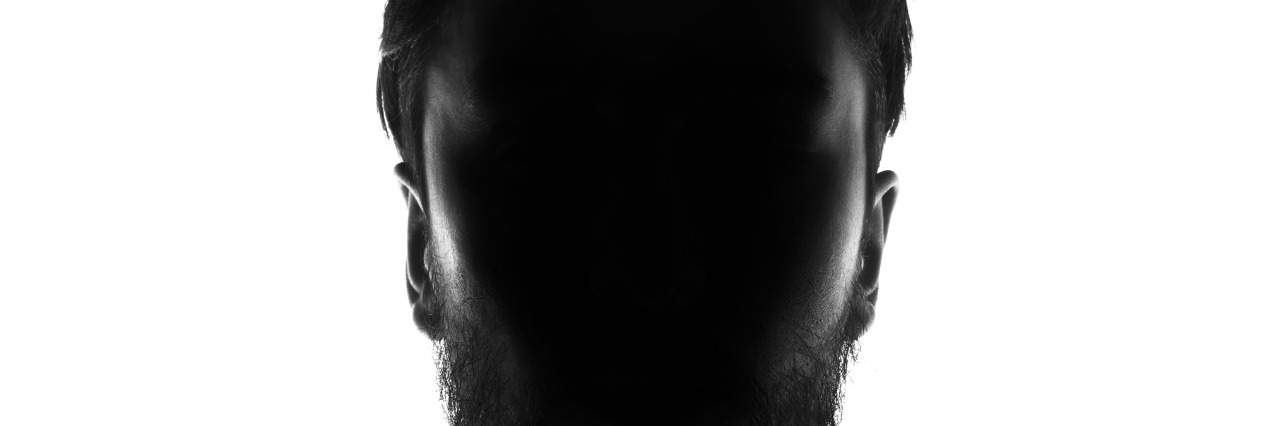 Hidden face in the shadow.male person silhouette.
