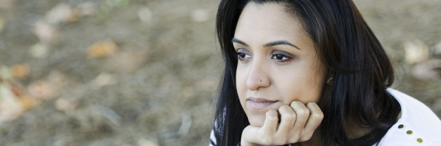 Frustrated young Indian woman contemplating her thoughts
