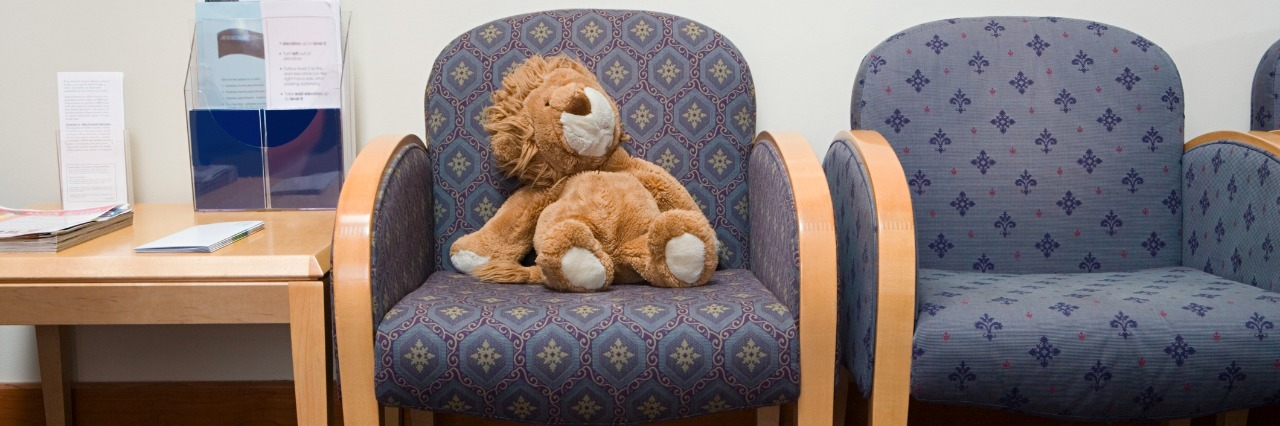 toy lion in hospital waiting room