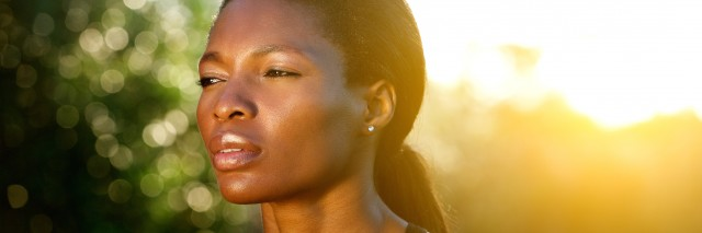 Close up portrait of an black woman outdoors