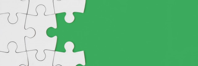 A puzzle in green background