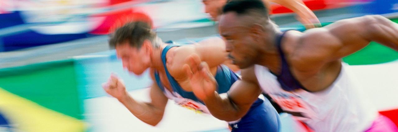 three men running in a race