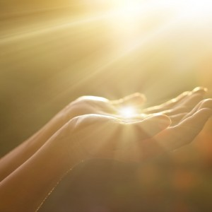 woman holding her hand in sunlight
